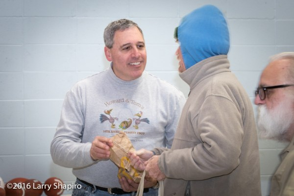 volunteer assists others on Thanksgiving
