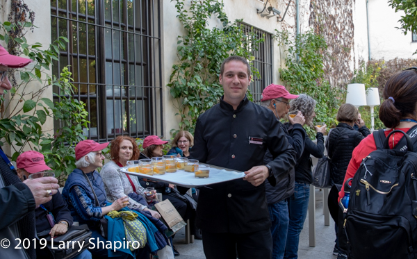 hotel waiter greets guests with fresh drinks in Spain