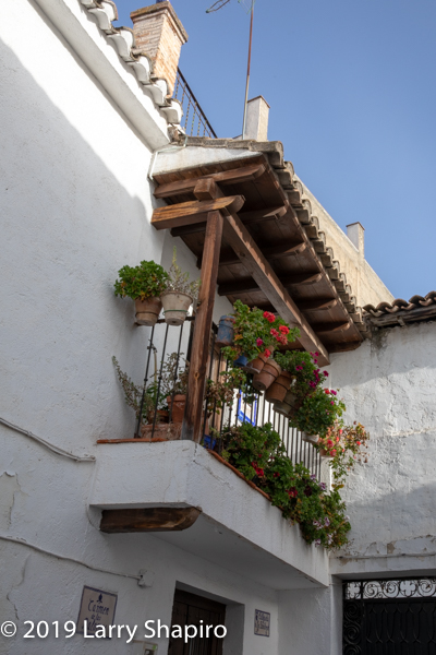 Spanish balcony with flower pots