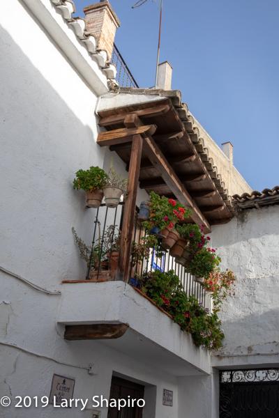Spanish balcony with flower pots