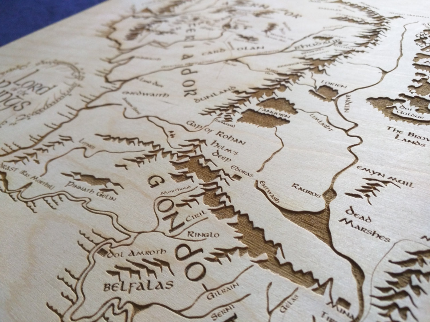 large wooden middle earth map engraved into wood lord of the rings map