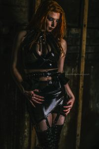 red-headed woman wearing Antidote London Latex black latex top and skirt. Founder Jennifer Brawls interviewed by erotic marketing agency Lascivious Marketing [credit: Anouk Dyonne Photography]