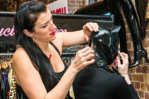 vendor attending to fitting at Le Boutique Bazaar alternative erotic fashion popup. Co-Founder Alexandra Houston interview with erotic marketing agency Lascivious Marketing [credit: Hyder Images]