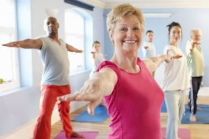 Mature-woman-at-front-of-exercise-class