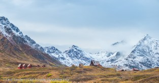 Hatcher Pass Lodge in golden color with now snow creeping down the Talkeetna Mountains. www.cecilsandersphotography.com
