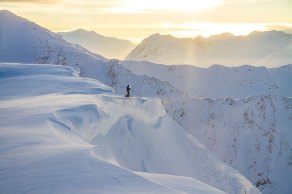 Joshua Foreman absorbing the last minutes of sunlight before his ski run in the Kenai Mountains.