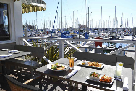 Located in Redondo Beach, has upped the waterfront dining ante in the South Bay with the opening of a spectacular new outdoor dining patio with fire pit, lounge area and seating for 80 overlooking King Harbor Marina.