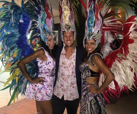 DJ Jason Stiegler of @JStieglerMusic posing with Brazilian dancers