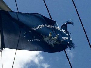 Flying the courtesy flag of the Conch Republic, with signs of wear.