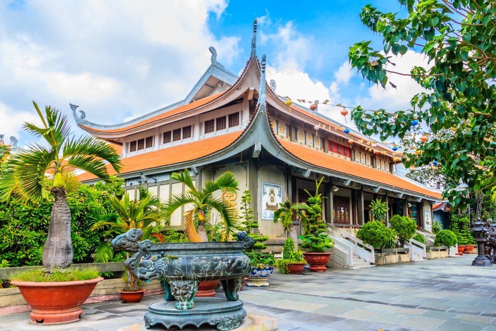 Morning at Vinh Nghiem Pagoda, ornate traditional style buddhist temple in Ho Chi Minh
