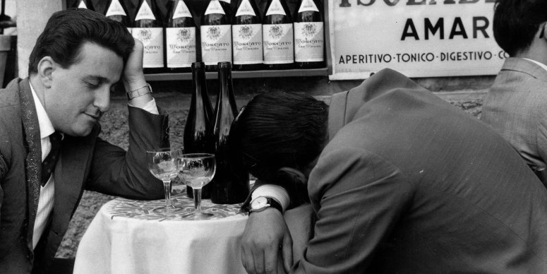 Classic Collection, Page 86, 10404106, Frascati, Italy, 23rd November 1957, Two men sit at a table, one with his head slumped on the table and the other practically asleep, with two empty bottles of wine in front of them