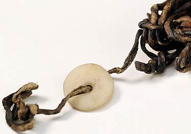 Il disco di marmo dolomitico e le cordicelle