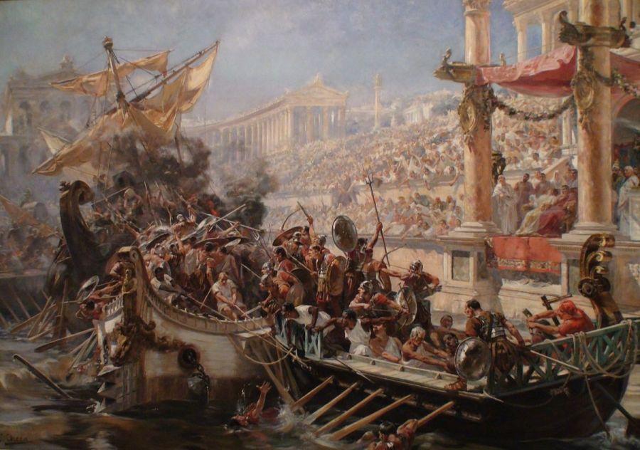 La storia delle Rievocazioni parte da lontano. La prima naumachia conosciuta è quella organizzata da Giulio Cesare a Roma nel 46 a.C. per il suo quadruplice trionfo e rievocò una battaglia navale tra Egizi e Fenici. Dopo aver fatto scavare un ampio bacino vicino al Tevere, nel Campo Marzio, capace di contenere vere biremi, triremi e quadriremi, Cesare ingaggiò tra i prigionieri di guerra 2000 combattenti e 4000 rematori. Nell'imagine uno spettacolo di naumachia dipinto nel 1894 da Ulpiano Checa