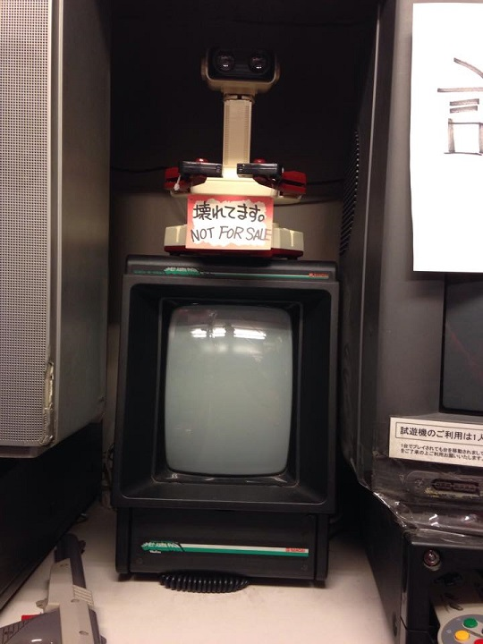 R.O.B.'s Famicom cousin sitting atop a Japanese Vectrex.