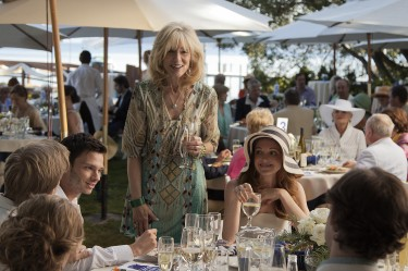 Veronika Goss (Judith Light) at the ''Keep Tahoe Blue'' benefit luncheon in LAST WEEKEND. Houseguests Luke Caswell (Devon Graye) and Blake Curtis (Jayma Mays) look on.
