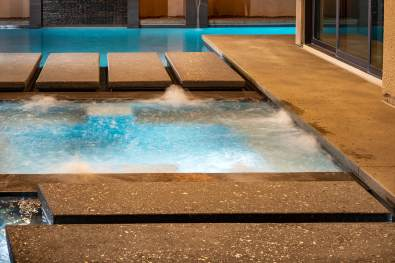 Aggregate Concrete Floating Steppers Modern Swimming Pool Feature by Clarity Pool Service of Las Vegas, Nevada