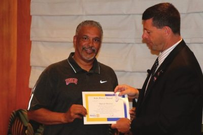 President Dave presents our Sole Power award to our speaker Marvin Menzies the UNLV rebel basketball coach.