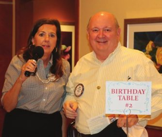 Bob Barnard is trying to be clever by not sitting at the birthday table. He deserves a fine.