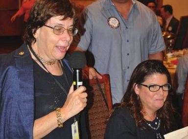 Visiting Rotarian Kathy Mahon enjoys fellowship with Katie Decker.
