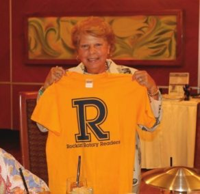 Marie Walsh models the reading with kids TShirt.