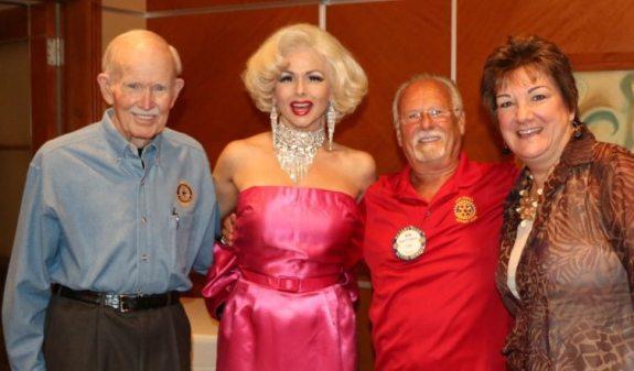 Our greeter Jennifer Lier, aka Marilyn Monroe poses with Jim Jones, Bob Werner and Deb Granda.