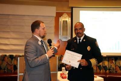 President Michael presents our speaker LVFR Chief Willie McDonald with our Share What You Can award