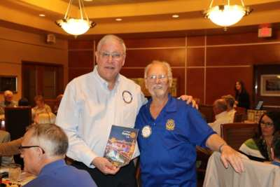 Robert Werner presented our visiting International Rotarian with our banner.