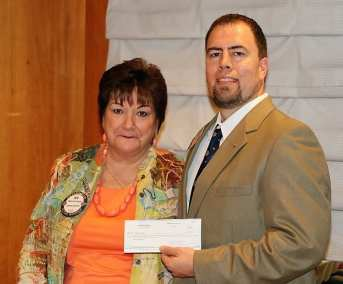 Deb Granda presented her check and other member checks totaling $6,500 in memory of her deceased husband Bill.