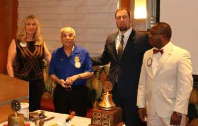 PEE Jackie Thornhill present PHF pins to John Ingeme (+5) and Kim Nyoni (his first)