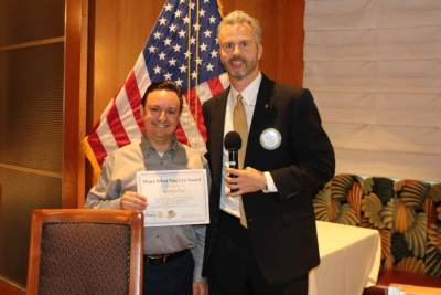 "President Jim Kohl presented our speaker Brian Rosenberg with our ""Share What You Can Award""."