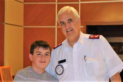 Salvation Army Major Randy Kinnamon enjoyed lunch with his grandson.