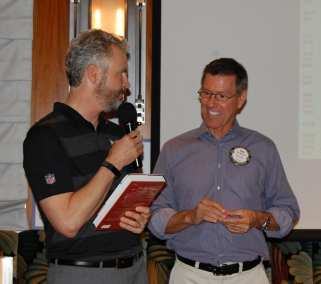 Dan Adamson receives the bonus drawing, The Cristo Rey Story, a book donated by our Guest Speaker Dan Schwarz.