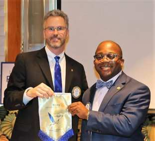 Joakim Nyoni presented President Jim with a banner from his homeland in Tanzania.