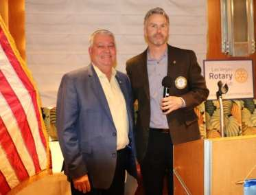 """President Jim Kohl presents our speaker Terry Jicinsky VP of the LVCVA with our """"Share What you Can Award"""""""