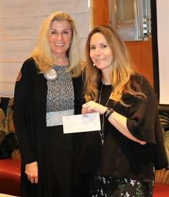 PE Jackie Thornhill presented a Community Grant check in the sum of $2,571.80 to Michelle Johnson of Junior Achievement. Michelle presented Jackie with a painting from her students.