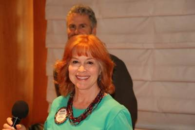 "Arleen Sirois did a pause and smile before leading ""God Bless America""."