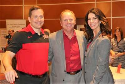 PP Jim Hunt poses with our new UNLV basketball coach T.J. Otzelberger and the UNLV Athletic Director Desiree Reed-Francois.