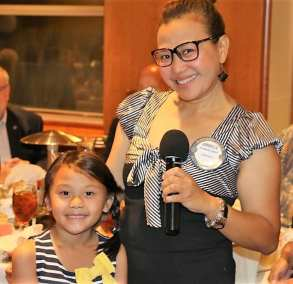 Jimmelle and her daughter pose for a picture while mom makes her announcements.