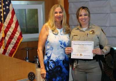 "President Jackie presents our ""Share What You Can Award' to our speaker Lt. Kimberly Brodeur."
