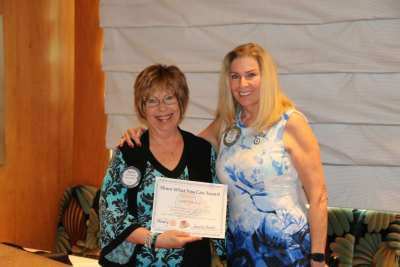 "President Jackie presents our speaker Judith Pinkerton with our ""Share What You Can Award""."