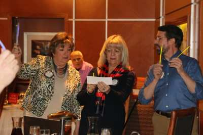 At PP Jackie's head table were Deb Granda, Rose Falocco and Bill Houghton holding their light sticks and joining in song.