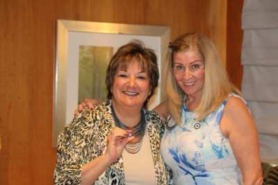 President Jackie presented Deb Granda with a Rotarian of the Month pin.