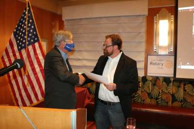 Our speaker Matt Seltzer receives our Share What You Can award.