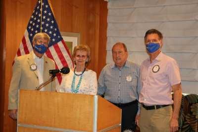 Brock Fraser and Dan Adamson help accept the donation