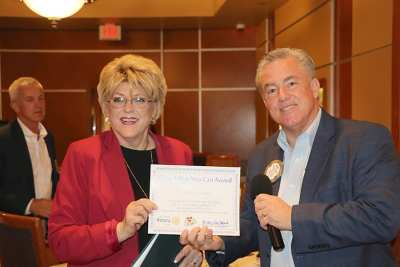 Mayor Goodman receives a Share What You Can award
