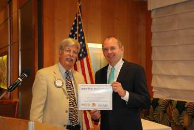 Guest speaker Terry Shirey, President of Nevada State Bank, receives a Share What You Can award