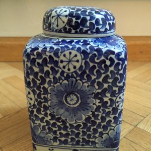 white and blue Delft jar