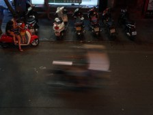 Mopeds zooming past