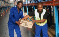 1547676633 Warehouse staff in South Africa move boxes