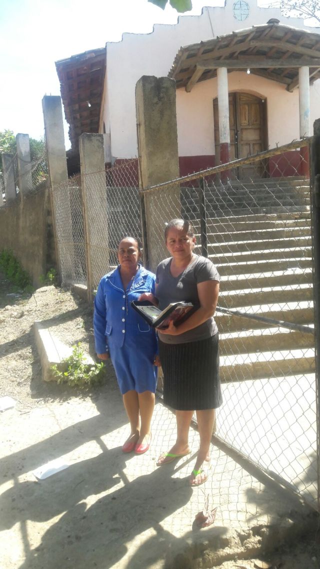 Gloria and a student's parent outside the school.